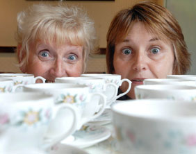 Lyn Shiel and Jayne Tooth from St Giles Hospice prepare for the Mammoth Coffee Morning Week