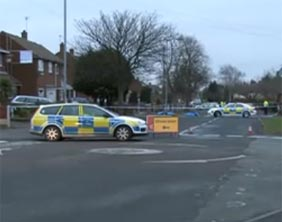 Police at the scene following the murder of Michael Eccles in January 2009