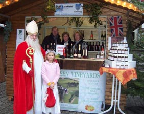 Saint Nicholas visits Halfpenny Green Vineyard's Stall at Limburg's Christmas market