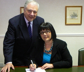Cllr David Smith and Rose Vakis sign the agreement