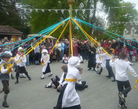 Maypole dancing at the 2009 Well Dressing event in Newborough