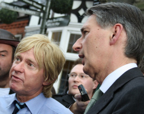 Michael Fabricant and Philip Hammond talk to HS2 protesters outside the Lichfield Guildhall