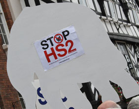 A Stop HS2 placard in the shape of a white elephant