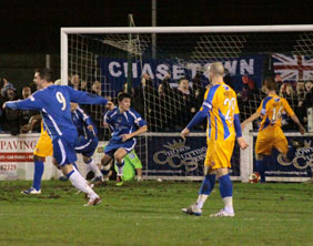 Chasetown players celebrate as Jimmy Turner's free-kick finds the net against Mansfield Town. Pic: Dave Birt