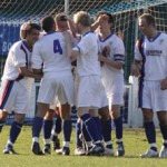 Whitby Town's players celebrate the equaliser. Pic: Dave Birt