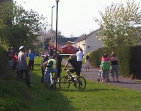 Residents look on as the Air Ambulance lands inside the police cordon