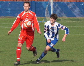 Chasetown's Chris Slater is challenged by Jack Watts. Pic: Dave Birt