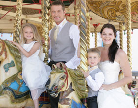 A wedding party on the carousel at Drayton Manor