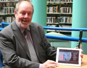 Cllr Pat Corfield with an e-book
