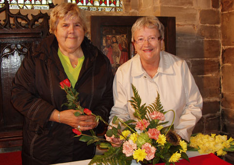 Members of the Hamstall Ridware flower arranging team working on one of the displays