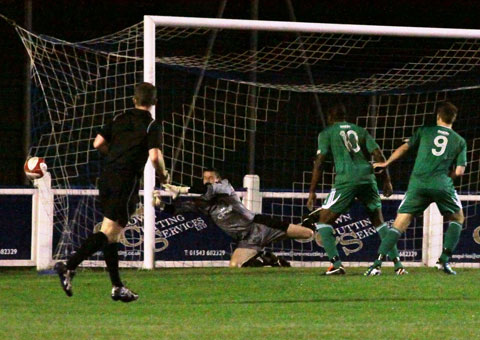 Chasetown keeper Ryan Price can't keep out Tom Bates' strike. Pic: Dave Birt
