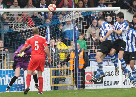Michael Wilde heads home a later winner for Chester against Chasetown. Pic: Dave Birt
