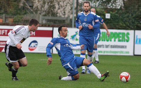 Levi Reid puts a tackle in for Chasetown. Pic: Dave Birt