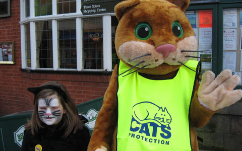 Homer the Lichfield and District Cats Protection mascot with a young supporter