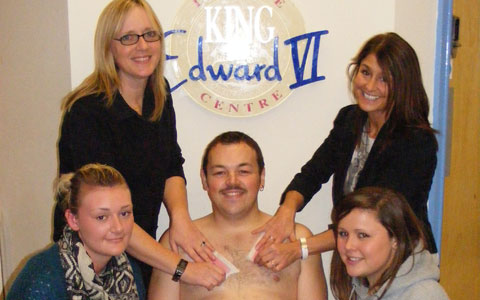 Scott Tennant gets ready for his sponsored chest wax for Children in Need