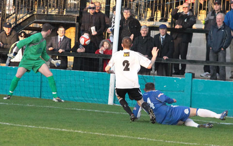 Paul Lundon fires past Chasetown keeper Ryan Price. Pic: Dave Birt