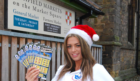 Natalie James gets ready for the scratchard giveaway