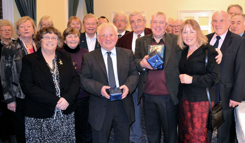 Councillors gather for the presentation to Peter Young