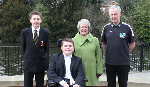Torchbearers Ben Kenyon, Tom Bolton and John May MBE with Cllr Val Richards
