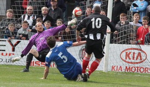 Chasetown FC goalkeeper Lee Evans is beaten by Steve Foster. Pic: Dave Birt