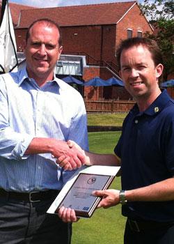 Simon Joyce (right) receives the GolfMark award from Sean Hammill of Staffordshire County Golf Partnership