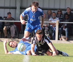 Two Chasetown players battle for the ball in midfield. Pic: Dave Birt