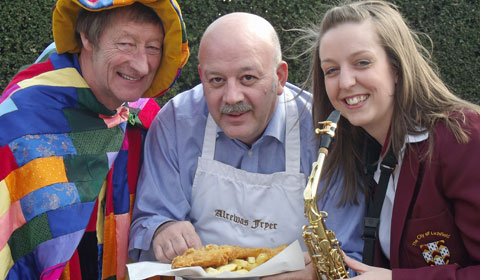 John Phillips from Lichfield Mysteries, with Chris Christoforou, owner of the Alrewas Fryer, and Natalie Foster, saxophonist with the City of Lichfield Concert Band