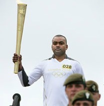 Corporal Johnson Beharry VC with his Olympic Torch