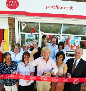 Harjinder Sanjhera (owner), Kath Holyoak (shop manager), Michael Fabricant, Ravinder Sanghera (owner), and Martin Lahert (senior manager, Post Office).