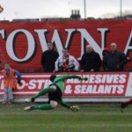 Lewis Clarkson beats Chasetown keeper Ryan Price. Pic: Dave Birt