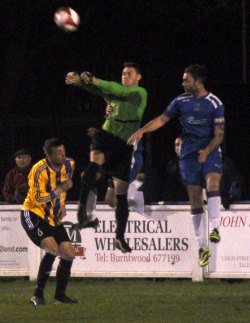Nick Wellecomme puts the Sporting Khalsa keeper under pressure. Pic: Pamela Mullins