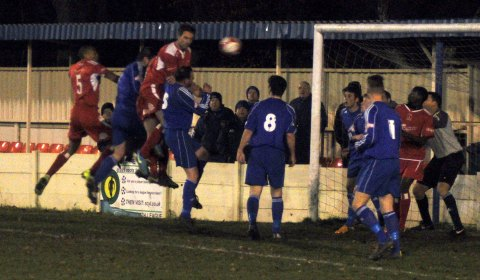 Nick Wellecomme climbs highest as the Kidsgrove goal comes under pressure. Pic: Pamela Mullins