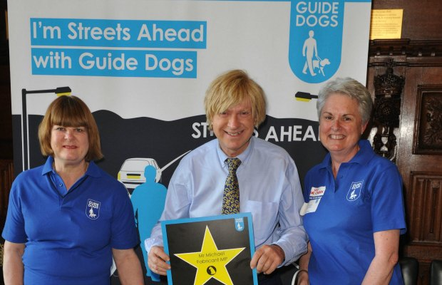 Michael Fabricant with representatives from Guide Dogs for the Blind