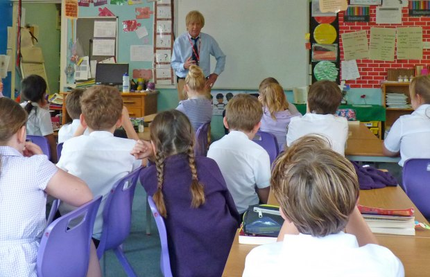 Michael Fabricant talking to pupils at St Joseph's RC Primary School