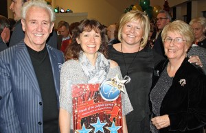 Tony Christie (left) presenting the Friends of the Garrick award for best amateur musical to Lichfield Operatic Society