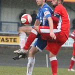 Chris Slater keeps a close eye on a Newcastle Town attacker. Pic: Dave Birt