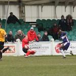 Stan Mugisha tucks the ball past the Leek keeper. Pic: Dave Birt