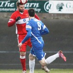 Chasetown's Chris Slater clears the danger. Pic: Dave Birt