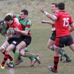 Sean Brennan tries to haul down a Ludlow player. Pic: Joanne Gough