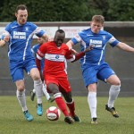 Stan Mugisha tries to wriggle away from two Newcastle Town players. Pic: Dave Birt