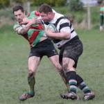 Sean Brennan is held off as he tries to tackle. Pic: Joanne Gough