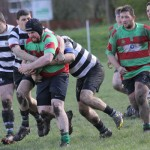 Brad Holmes tries to burst through. Pic: Joanne Gough