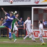 James Dance forces the Lincoln keeper to punch clear. Pic: Pamela Mullins