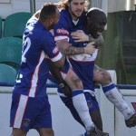 James Dance and Nick Turton congratulate goalscorer Henry Eze. Pic: Pamela Mullins