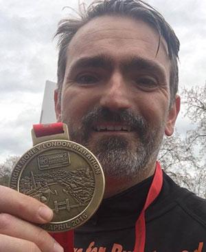 Cllr Darren Ennis with his London Marathon medal