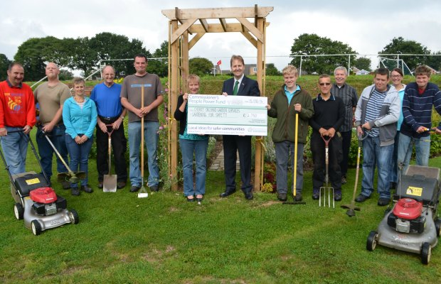 Police and Crime Commissioner Matthew Ellis hands over a cheque to members of Cherry Orchard Garden Services