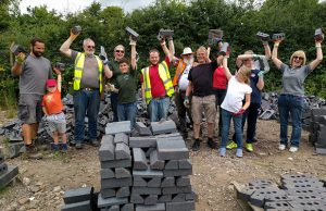 The scouts and their helpers sorting bricks for the Lichfield Canal