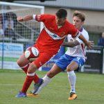 Mitchell Piggon holds off a defender. Pic: Pamela Mullins