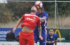 Chris Slater battles for the ball in the air. Pic: Pamela Mullins