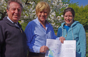 Peter Button and Lisa Farrington show Michael Fabricant MP one of their plans for a 'Better Burntwood'